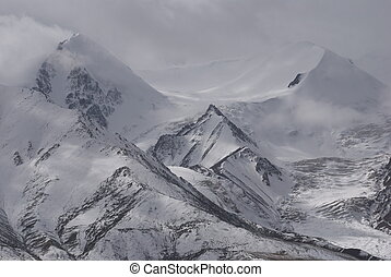 snow mountains - a shot of snow mountains in west China