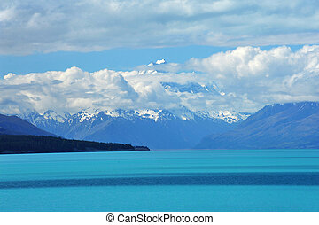 Lake Pukaki - Mighty Mt Cook is appearing from the clouds...