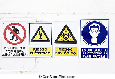 hazard and danger signs in a wall