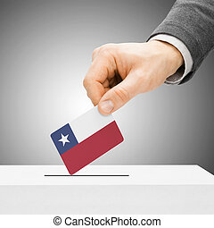 Voting concept - Male inserting flag into ballot box - Chile
