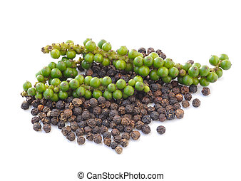 Black peppercorn and Bunches of fresh green pepper isolated...