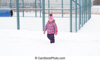 Little Girl Going in Deep Snow on Playground
