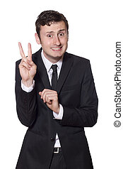 intimidated businessman showing the peace sign - intimidated...