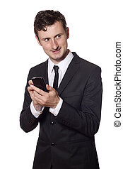 businessman twitters with a smartphone