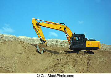 Yellow excavator, excavation work at a construction site