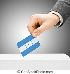 Voting concept - Male inserting flag into ballot box -...