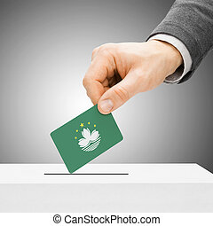 Voting concept - Male inserting flag into ballot box - Macau