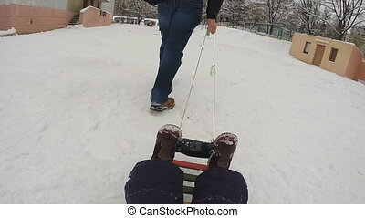 Father with Baby Drag the Sled, Slow Motion