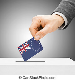 Voting concept - Male inserting flag into ballot box - Cook...