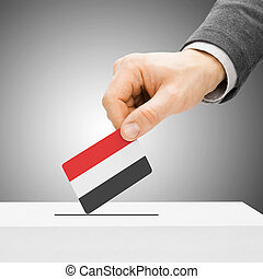 Voting concept - Male inserting flag into ballot box - Yemen