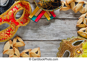 Purim background - Hamantaschen cookies or Hamans ears,...