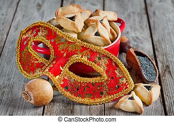 Purim - Hamantaschen cookies or Hamans ears and carnival...