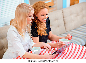 Beautiful women in the cafe - Surfing web in cafe Top view...