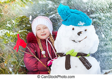 Portrait of a girl with snowman and snow flakes - Portrait...