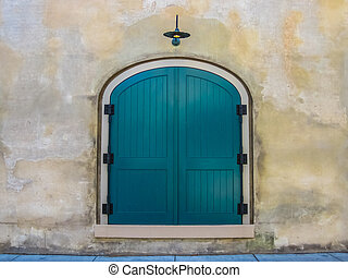 Teal Door - A teal door against a neutral wall background