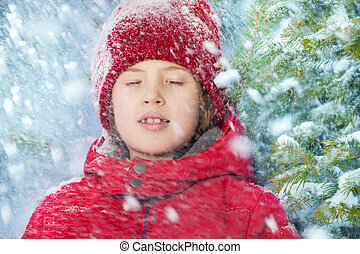 Portrait of boy with closed eyes and falling snow - Portrait...