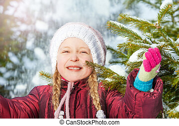 Portrait of happy girl with fir tree and snow - Portrait of...