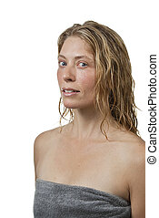Blond woman in spa, relaxed, looks to the camera