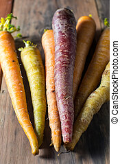 Multiple colored organic carrots vegetable - Organic stack...