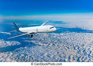 Passenger airliner flight in the blue sky - Passenger...