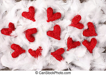 red hearts on white feathers