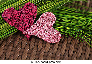 Pink and rose hearts on green grass