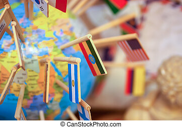 national flags stuck in the globe - Close-up national flags...