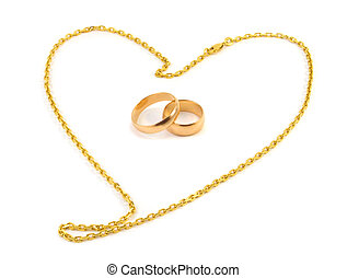 Golden wedding rings with a chain composed of a heart on a...