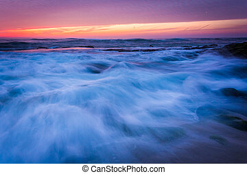 Waves in the Pacific Ocean at sunset, in La Jolla, California.