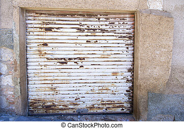old rusty blind in a house