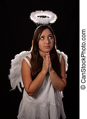 Angel Praying - Portrait of a pretty hispanic teen age girl...