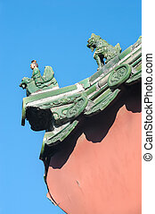 Traditional ceramic figures on the roof of the Lama Temple, Beijing