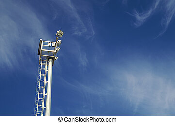 Floodlight with blue sky and clouds
