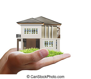 House model concept in hand - House model concept in the...