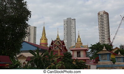 buddha temple against skyscrapers - buddha temple at the...