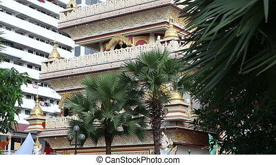 Buddha temple in Penang among palms at the background of...