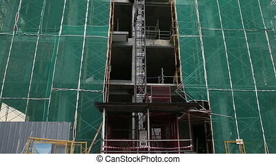 scaffolding and lift in building skyscraper in asian city