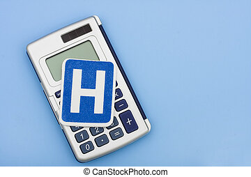 Calculating Healthcare Costs - A calculator and a hospital...
