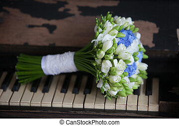 Wedding bouquet for bride on the piano
