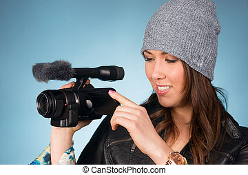 Hip Young Adult Female Points Video Camera Making Movie