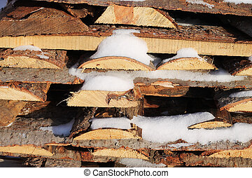 Woodpile - Background of stacked firewood in woodpile...