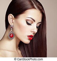 Portrait of beautiful brunette woman with earring. Perfect...