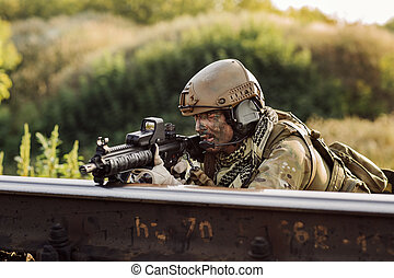 soldiers in an ambush aiming at the enemy - rangers in an...