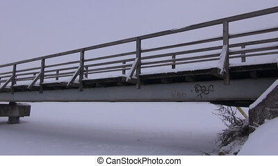 old wooden bridge in winter fog - old wooden long bridge on...