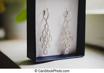 Jewelry box with luxury wedding earrings. Wedding background.