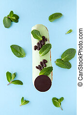 exquisite cream dessert eclair with fresh mint leaves