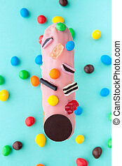 exquisite cream dessert eclair sprinkled with candy