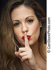Beautiful Woman commanding silence - Portrait of Beautiful...