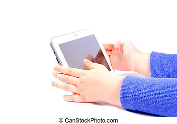 Tablet in hands of the child