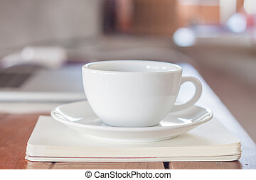 White coffee cup on work station, stock photo